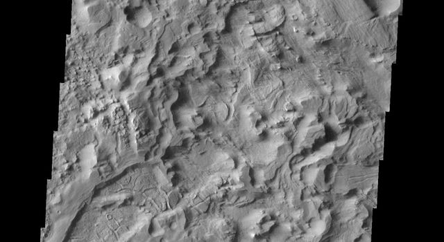 This image from NASA's Mars Odyssey shows the western Tharsis region on Mars containing many different surface textures. Both volcanism and wind action have played a part in producing the interesting mix of textures.