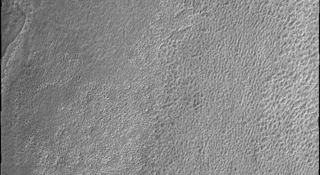 This image from NASA's Mars Odyssey shows Mars' south polar ice develops many different surface textures during the summer time. This texture is reminiscent of a sponge.
