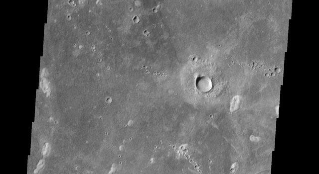 This image from NASA's Mars Odyssey shows craters on Mars with asymmetric ejecta blankets, typically formed by oblique impacts. The region of 'missing' ejecta indicates the direction of the incoming meteorite.