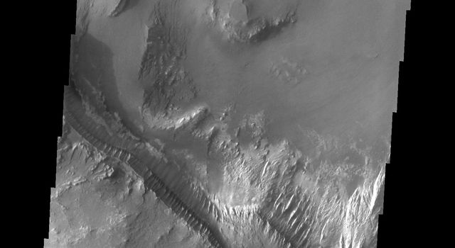 This image from NASA's Mars Odyssey shows part of the layered deposits found in Melas Chasma on Mars.
