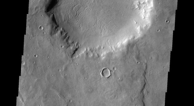 This image from NASA's Mars Odyssey shows an unnamed crater in Arabia Terra on Mars appearing to be the source of the channel that runs to the top of the frame. This channel/crater combination is part of a much larger channel system in Arabia Terra.