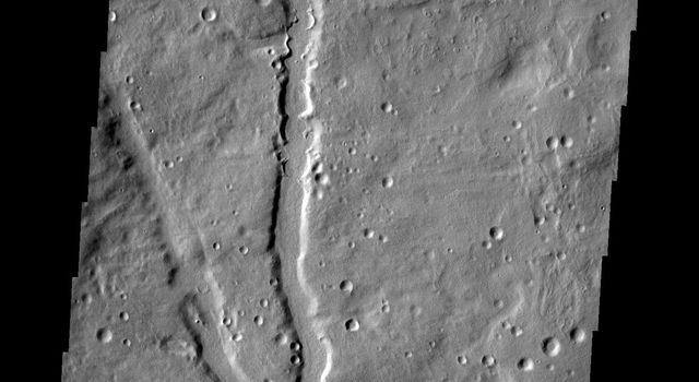 This image from NASA's Mars Odyssey shows a channel located in the plains of Terra Sabaea on Mars.