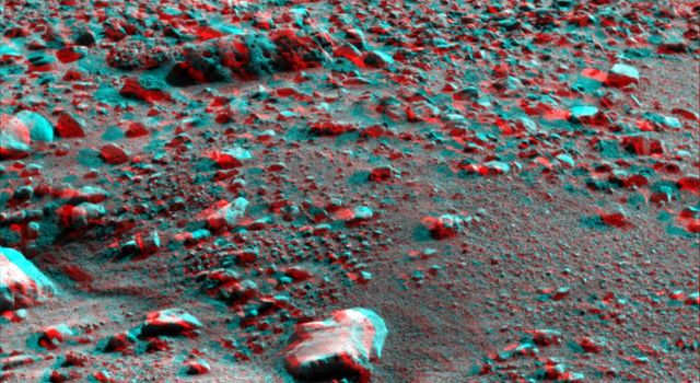 This anaglyph, acquired by NASA's Phoenix Lander on Jun. 26, 2008, shows a stereoscopic 3D view of the Martian surface near the lander. 3D glasses are necessary to view this image.