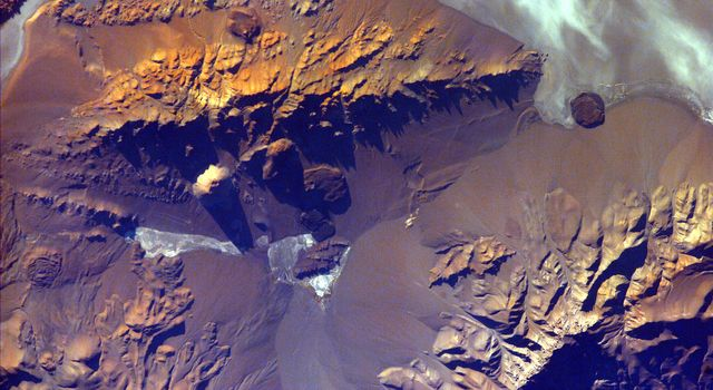 The Andes Mountains, part of the Southern Cordillera formed from subduction zone volcanism at the convergent boundary of the Nazca plate and the South American plate. This image if from NASA's EarthKAM.