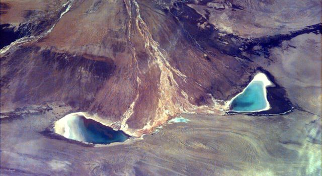 This image captures the beauty of a major alluvial fan in Tsinghai, a province located in Northwestern China. This archival image was taken from NASA's Space Shuttle in 1997 as part of its ISS EarthKAM mission.