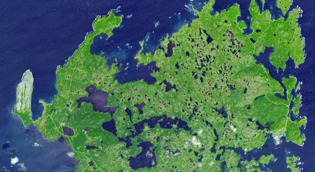 L'Anse aux Meadows is a site on the northernmost tip of the island of Newfoundland, located in the Province of Newfoundland and Labrador, Canada, where the remains of a Viking village were discovered in 1960. This image is from NASA's Terra satellite.