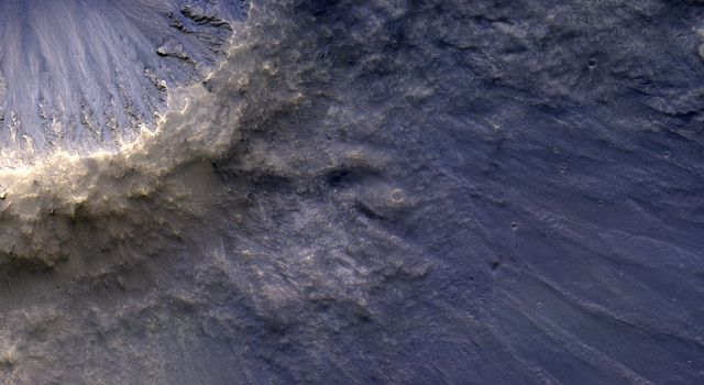 NASA's Mars Reconnaissance Orbiter captured this image of impact ejecta, a material that is thrown up and out of the surface of a planet as a result of the impact of an meteorite, asteroid or comet.