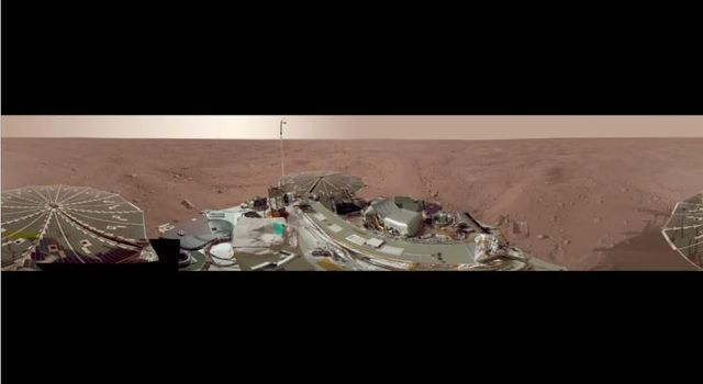 This view combines more than 500 images taken after NASA's Phoenix Mars Lander arrived on an arctic plain at 68.22 degrees north latitude, 234.25 degrees east longitude on Mars.