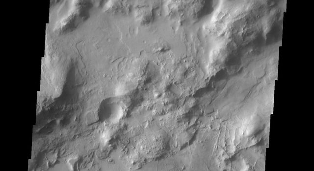 This image from NASA's Mars Odyssey shows a region of crisscrossing linear ridges located just north of Nili Fossae on Mars.