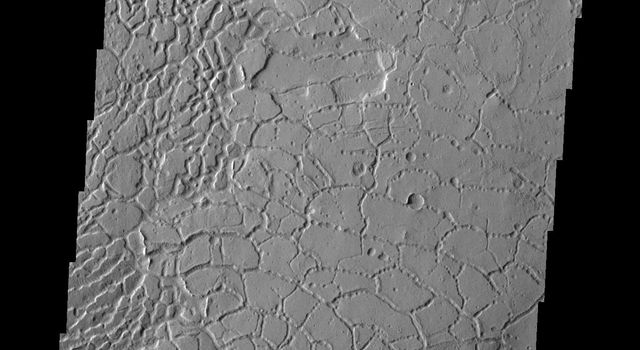 This image from NASA's Mars Odyssey shows Averuns Colles on Mars. These broken blocks and arcuate fractures mark the transition region between the southern highlands and the northern lowlands of Mars.