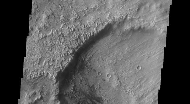 This image from NASA's Mars Odyssey shows part of Tagus Valles and a small field of dunes in an unnamed crater on Mars.