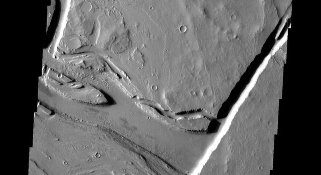 The channels seen in this image from NASA's Mars Odyssey spacecraft are all volcanic in origin. Many lava channels begin at vents, such as the fracture in this image.