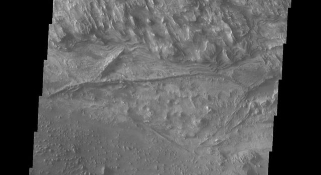 This image from NASA's Mars Odyssey shows part of the floor of Candor Chasma on Mars.