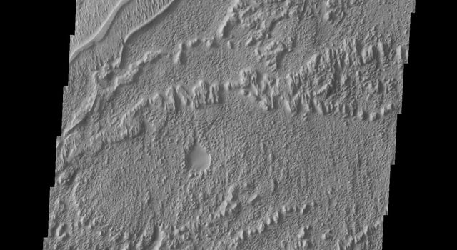 This image from NASA's Mars Odyssey shows a system of sinuous ridges which are remnants of a channel system on Mars.