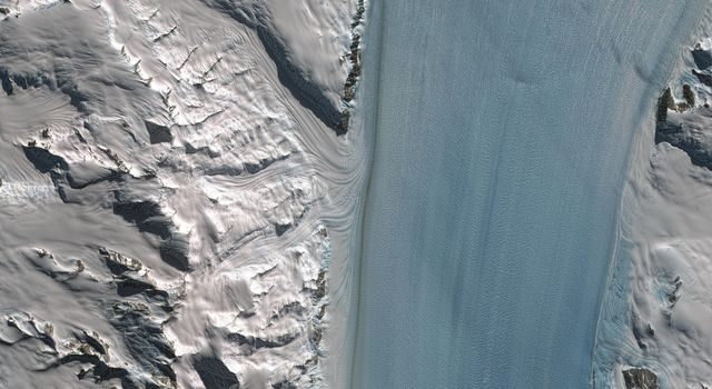 Byrd Glacier is a major glacier in Antarctica; it drains an extensive area of the polar plateau and flows eastward between the Britannia Range and the Churchill Mountains to discharge into the Ross Ice Shelf. This image is from NASA's Terra satellite.