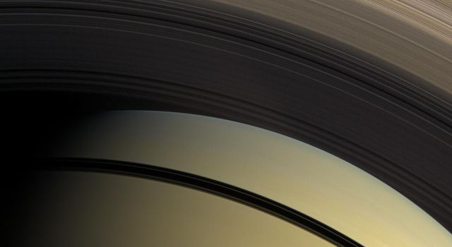 This natural color view taken on Feb. 28, 2009,from NASA's Cassini spacecraft, with hues of yellow and brown, highlights the myriad gradations in the transparency of Saturn's inner rings.