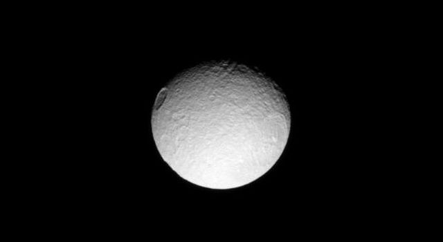 Two large craters named after characters in Homer's Odyssey take the stage in this scene on Saturn's moon Tethys. The crater on the right is the Odysseus crater in this image taken by NASA's Cassini spacecraft taken on Apr. 12, 2009.