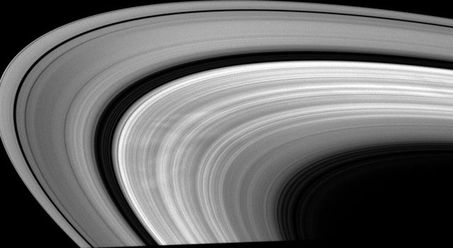 This low-phase image taken by NASA's Cassini spacecraft on April 10, 2009 shows bright areas between dark spokes in Saturn's B ring.