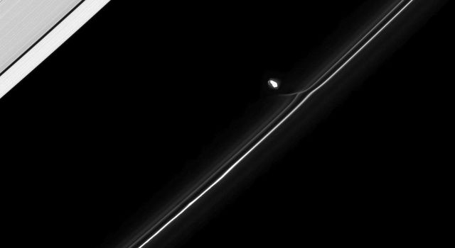 Fresh from an encounter with Saturn's F ring, the moon Prometheus continues in its orbit in taken by NASA's Cassini spacecraft taken on April 24, 2009.
