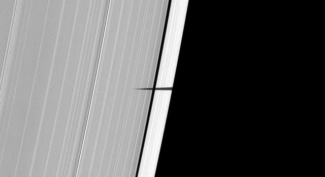 NASA's Cassini spacecraft captured the shadow of Saturn's tiny moon Pandora sneaking onto the planet's main rings on May 9, 2009.
