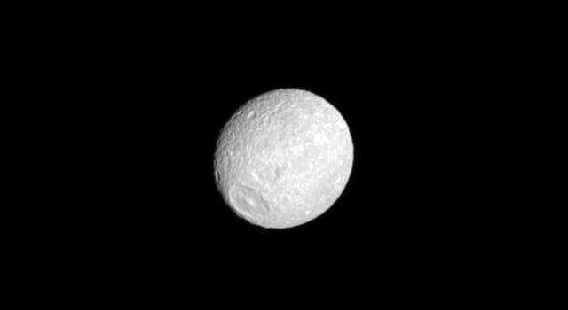 The oblate shape of Saturn's moon Mimas is presented in this image from NASA's Cassini spacecraft. The moon appears flattened at the poles with an equatorial bulge.