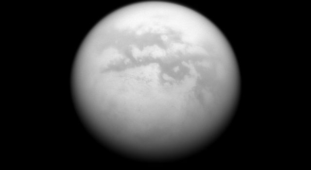 NASA's Cassini spacecraft charts a quartet of dark albedo features on the moon Titan. From upper left to lower right of the image are Fenzal, Aztlan, Aaru and Senkyo.