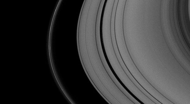 The shepherding moon Pandora, near the bottom of the image, casts a shadow on Saturn's thin F ring as the planet nears its August 2009 equinox. This image is from NASA's Cassini spacecraft.