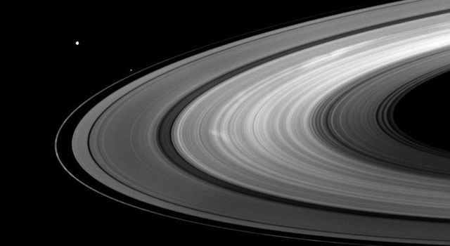Saturn's moons Mimas and Pandora join bright B ring spokes in this image from NASA's Cassini spacecraft captured on Aug. 30, 2009.