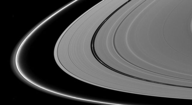 About a month after Saturn's August 2009 equinox, shadows continue to grace the planet's rings in this image taken by NASA's Cassini Orbiter. Pan runs through the center of this image.