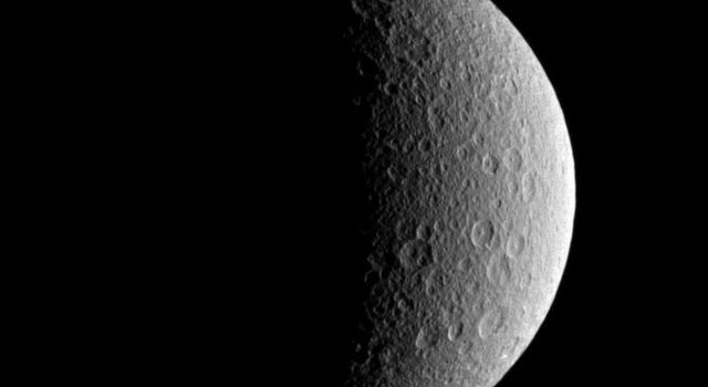 NASA's Cassini spacecraft looks toward the battered surface of the moon Rhea.