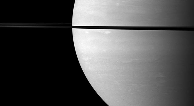 From just above the plane of Saturn's rings, NASA's Cassini spacecraft snapped this shot of Saturn two months after Saturn's August 2009 equinox, showing the shadow of its rings as a narrow band on the planet.