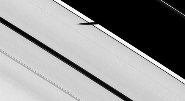 In this image from NASA's Cassini spacecraft taken on Jan. 8, 2009, the moon Epimetheus is not visible, but it has begun to cast its shadow onto the A ring.