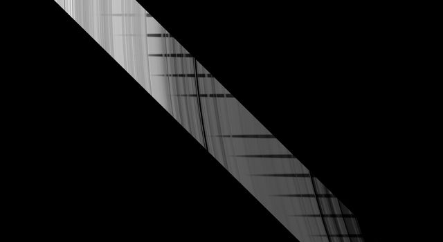Part of the shadow of Saturn's moon Mimas appears as if it has been woven through the planet's rings in this unusual series of images from NASA's Cassini spacecraft.