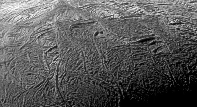 NASA's Cassini spacecraft captured this wide-angle image showing the south polar region of Saturn's moon Enceladus. The outlined area focuses on Baghdad Sulcus, a fracture in the south polar region.