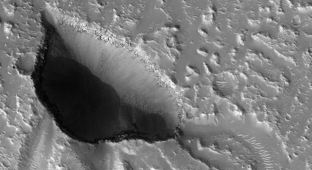NASA's Mars Reconnaissance Orbiter captured this image of Hebrus Valles, located in the plains of the Northern lowlands, just west of the Elysium volcanic region.