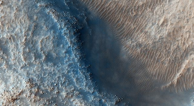 This observation from NASA's Mars Reconnaissance Orbiter targets some unknown fill or mantling material within valleys on a crater floor and within a central pit.