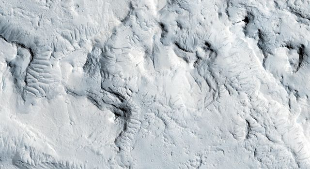 This observation from NASA's Mars Reconnaissance Orbiter locates what appears to be a graben (a fault-bounded valley) on a large scale, and locally became a vent region for lava flows.
