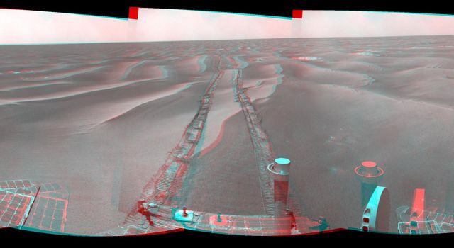 NASA's Mars Exploration Rover Opportunity used its navigation camera to take the images combined into this stereo 180-degree view on Feb. 13, 2009. 3D glasses are necessary to view this image.