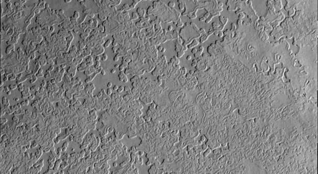 This image from NASA's Mars Odyssey shows Mars' south polar region featuring some of the unusual surface textures found on the cap. It is the heating of the surface during spring and summer that have produced these interesting textures.