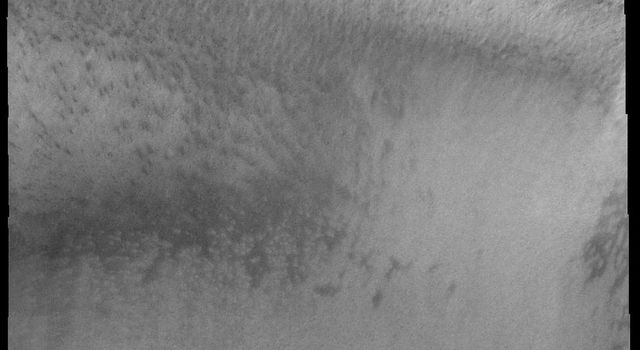 The numerous layers of Mars' south polar cap are shown in cross-section in this image from 2001 Mars Odyssey spacecraft.