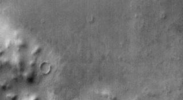 This daytime infrared image shows the large sand sheet on the floor of Charlier Crater. The brightness is due to the warmth of the sand during the day.