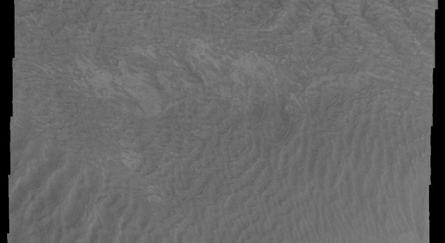 This VIS image of Charlier Crater's sand sheet was taken at the same time as yesterday's THEMIS IR image. In this image the dunes are darker than the surroundings, unlike yesterday's thermal image.