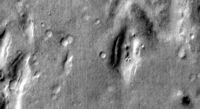 This daytime infrared 2001 Mars Odyssey image shows part of the extensive dune field on the floor of Russell Crater on Mars.