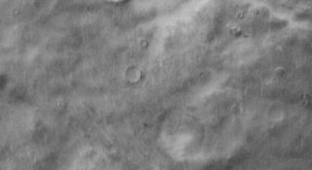 This daytime 2001 Mars Odyssey image of Promethei Terra shows bright dune sheets on the floor of two unnamed craters on Mars.