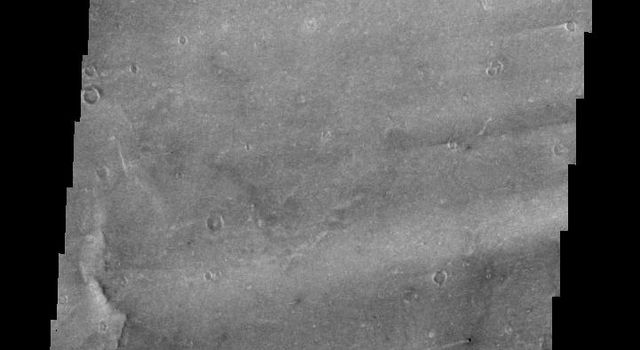This 2001 Mars Odyssey image shows windstreaks located on the Syrtis Major Volcanic complex on Mars.