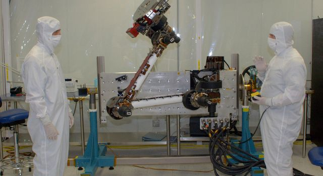 Engineers from NASA's Jet Propulsion Laboratory and Alliance Spacesystems are testing the range of motion of the Mars Science Laboratory rover's robotic arm joints.