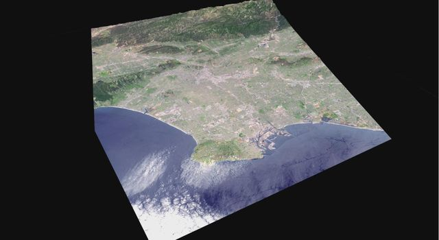 Data from JPL's Advanced Spaceborne Thermal Emission and Reflection Radiometer instrument on NASA's Terra satellite provides views of the L.A. Basin, including Dodger Stadium, the L.A.X. airport and JPL.