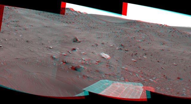 This stereo scene combines frames taken by the navigation camera on NASA's Mars Exploration Rover Spirit during the 1,866th Martian day, or sol, of  Spirit's mission on Mars (April 3, 2009). You will need 3-D glasses to view this image.