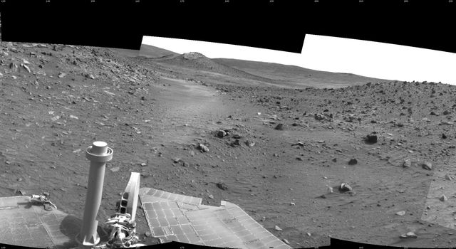 This scene combines five frames taken by the navigation camera on NASA's Mars Exploration Rover Spirit during the 1,871st Martian day, or sol, of Spirit's mission on Mars (April 8, 2009). It spans 180 degrees, with east on the left, south at the center