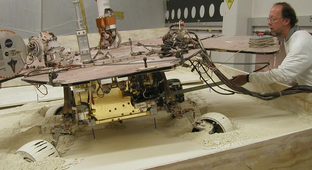 In this view from behind a test rover at NASA's Jet Propulsion Laboratory, Pasadena, Calif., the rear wheels of the rover are turned toward the left, and the left-front wheel is turned toward the the right.